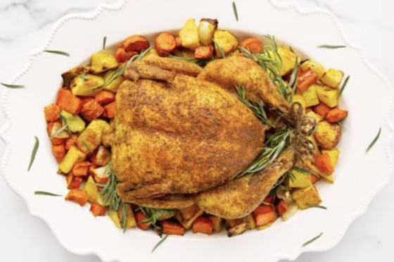 Curry-Spiced Roast Chicken Served With Potatoes, Carrots, And Onion | Natural Grocers