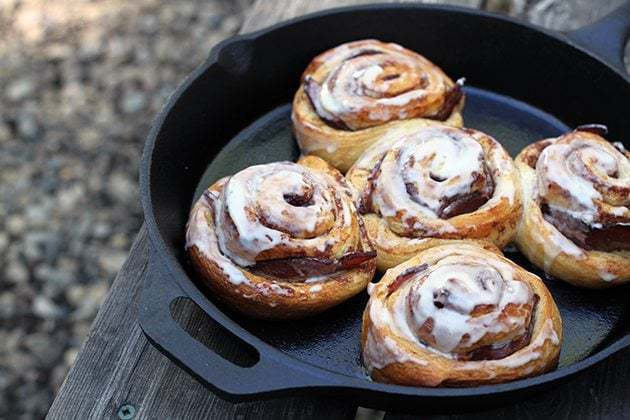 Camping Recipes: Bacon Stuffed Cinnamon Buns in a Skillet - The Kitchen Magpie