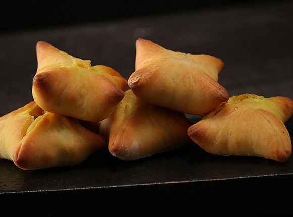 How to make Paneer Parcels - Paneer mixture wrapped in naan dough and baked.